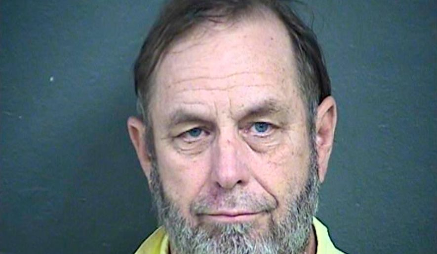 FILE - This April 4, 2018 file booking photo provided by the Wyandotte County Detention Center, shows Jeff Henry, co-owner of the Schlitterbahn water park, who is charged in a 10-year-old boy's decapitation death on a 17-story waterslide that was promoted as the world's largest. Henry pleaded not guilty Thursday, April 5, 2018, to second-degree murder in the in the 2016 death of Caleb Schwab on the massive waterslide. (Wyandotte County Detention Center via AP, File)