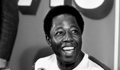 2. Hank Aaron - 755 home runs, 12364 AB, .305 batting average. Atlanta Braves baseball player Hank Aaron speaks during a press conference after hitting his 715th home run during a game against the Los Angeles Dodgers, in Atlanta. The 40th anniversary of Hank Aaron's 715th home run finds the Hall of Famer, now 80, coping with his recovery from hip surgery. The anniversary of his famous homer on April 8, 1974 will be celebrated before the Braves' home opener against the Mets on Tuesday night, April 8. (AP Photo/File)