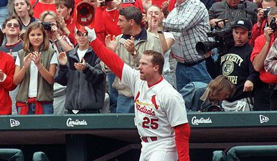 11. Mark McGwire - 583 home runs, 6187 AB, .263 batting average. St. Louis Cardinals' Mark McGwire comes out for a curtain call and acknowledges the crowd after hitting his 65th home run of the season in the first inning against the Chicago Cubs, Sunday, Oct. 3, 1999, at Busch Stadium in St. Louis.(AP Photo/Mary Butkus)