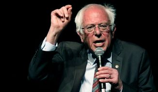 In this April 4, 2018 photo, Sen. Bernie Sanders, I-Vt., speaks on a question during a town hall meeting with Jackson Mayor Chokwe Antar Lumumba, examining economic justice 50 years after the assassination of Dr. Martin Luther King Jr., in Jackson, Miss. (AP Photo/Rogelio V. Solis) **FILE**