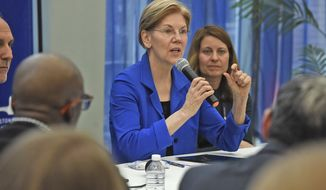 U.S. Sen. Elizabeth Warren, D- Mass., speaks during a roundtable discussion at Boston Healthcare for the Homeless Program on Albany Street on Friday, April 6, 2018. Warren is calling for the federal government to treat the opioid addiction crisis in a way similar to how it attacked the AIDS epidemic in the 1980s. (Patrick Whittemore/The Boston Herald via AP)