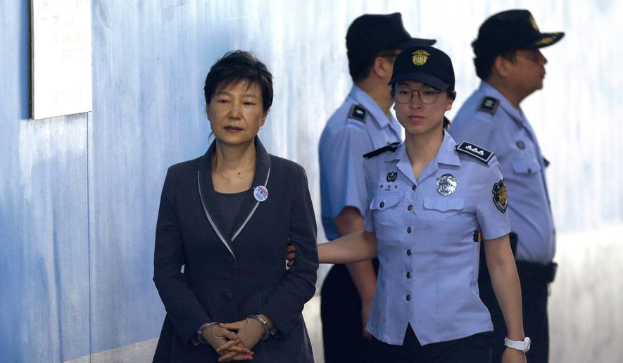In this Aug. 7, 2017, file photo, former South Korean President Park Geun-hye, left, arrives for her trial at the Seoul Central District Court in Seoul, Monday, Aug. 7, 2017. (AP Photo/Ahn Young-joon, File)