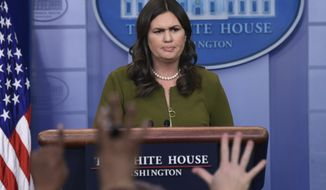 White House press secretary Sarah Huckabee Sanders listens to a reporter's question during the daily briefing at the White House in Washington, Friday, April 6, 2018. Sanders was asked questions about trade, the stock market and other topics. (AP Photo/Susan Walsh)
