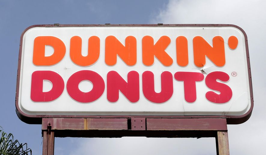 In this Aug. 3, 2017, file photo shows a Dunkin' Donuts sign at a store in Hialeah, Fla. (AP Photo/Alan Diaz, File)