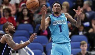 Charlotte Hornets' Malik Monk (1) loses control of the ball as he was fouled by Orlando Magic's Rodney Purvis, left, while going up for a shot during the second half of an NBA basketball game Friday, April 6, 2018, in Orlando, Fla. (AP Photo/John Raoux)