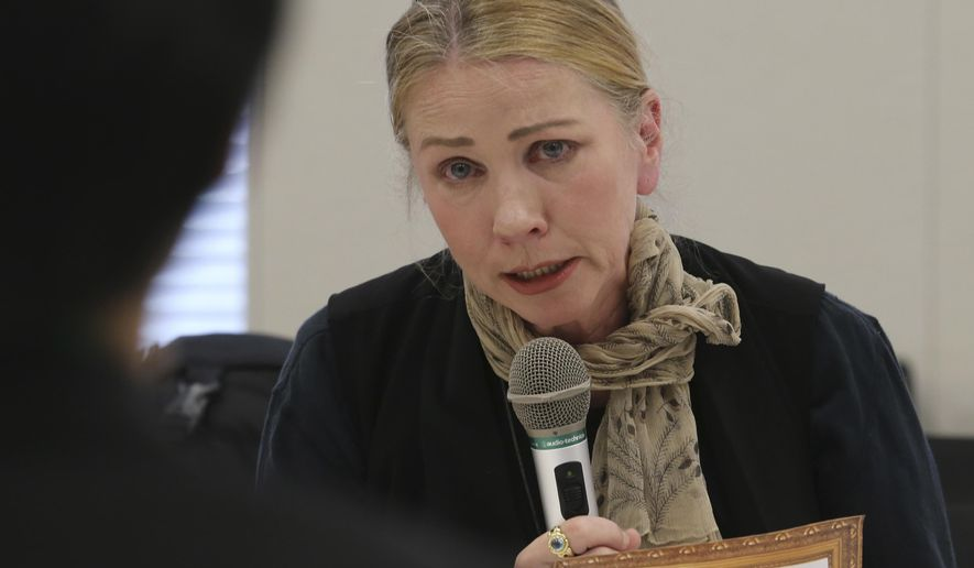 Catherine Fisher of Australia speaks during a meeting with Japanese government officials in Tokyo, Friday, April 6, 2018. Fisher says she was raped by a U.S. sailor in Japan is demanding Tokyo do more to protect victims of U.S. military personnel stationed here. (AP Photo/Koji Sasahara)