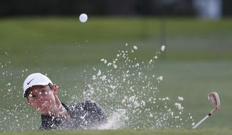 Rory McIlroy, of Northern Ireland, hits from a bunker on the 17th hole during the first round at the Masters golf tournament Thursday, April 5, 2018, in Augusta, Ga. (AP Photo/David Goldman)