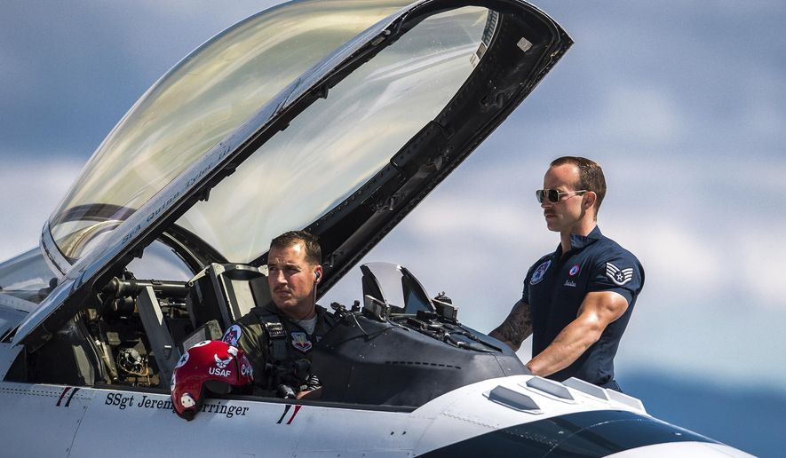 In this March 14, 2018, photo released by the U.S. Air Force, Maj. Stephen Del Bagno, Thunderbird 4/Slot Pilot, left, and Staff Sgt. Michael Meister, Thunderbird 4 Dedicated Crew Chief, await the signal to start their F-16 Fighting Falcon during a practice show at Nellis Air Force Base, Nev. Del Bagno was killed when his aircraft crashed on the Nevada Test and Training Range during a practice aerial demonstration on April 4, 2018. (Master Sgt. Christopher Boitz/U.S. Air Force Photo via AP)