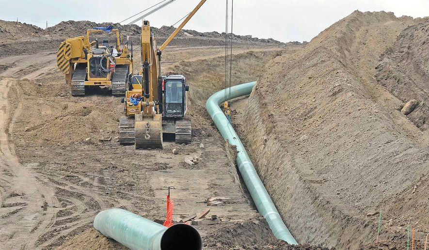 This photo taken Oct. 5, 2016, shows sections of the Dakota Access oil pipeline under construction are seen near St. Anthony in Morton County, N.D. The developer of the Dakota Access oil pipeline has submitted a court-ordered spill response plan for the Lake Oahe reservoir on the Missouri River in the Dakotas. The document was ordered by a federal judge overseeing a lawsuit against the pipeline. The American Indian tribe spearheading the legal battle isn't happy with the company's efforts and is taking steps of its own to protect its water supply.(Tom Stromme/The Bismarck Tribune via AP)
