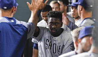 San Diego Padres' Jose Pirela, center, celebrates after scoring a run on a passed ball by Houston Astros catcher Brian McCann during the first inning of a baseball game Friday, April 6, 2018, in Houston. (AP Photo/Eric Christian Smith)