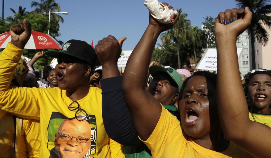 Protesters in support of former president Jacob Zuma protest in Durban South Africa, Friday, April 6, 2018.  Zuma is expected to appear at the High Court on charges of fraud, racketeering and money laundering. (AP Photo/Themba Hadebe)