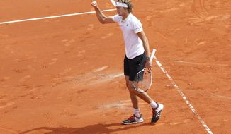 Germany's Alexander Zverev reacts during his World Group Quarter final Davis Cup tennis match against Spain's David Ferrer at the bullring in Valencia, Spain, Friday April 6, 2018. (AP Photo/Alberto Saiz)