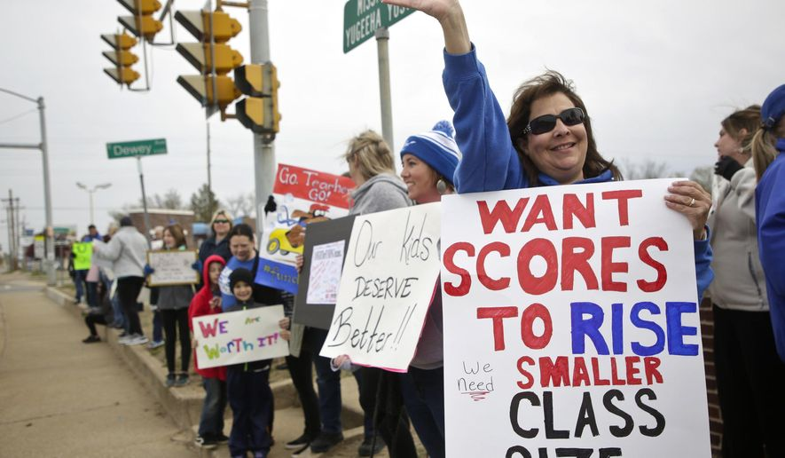 Sapulpa Middle School teacher Vina Janitz and others protest in front of Sapulpa High School in Tulsa, Okla., on day 4 of the teacher walkout Thursday, April 5, 2018.  Thousands of teachers, students and their supporters have thronged the Capitol for four straight days seeking more funding for schools.  (Mike Simons/Tulsa World via AP)