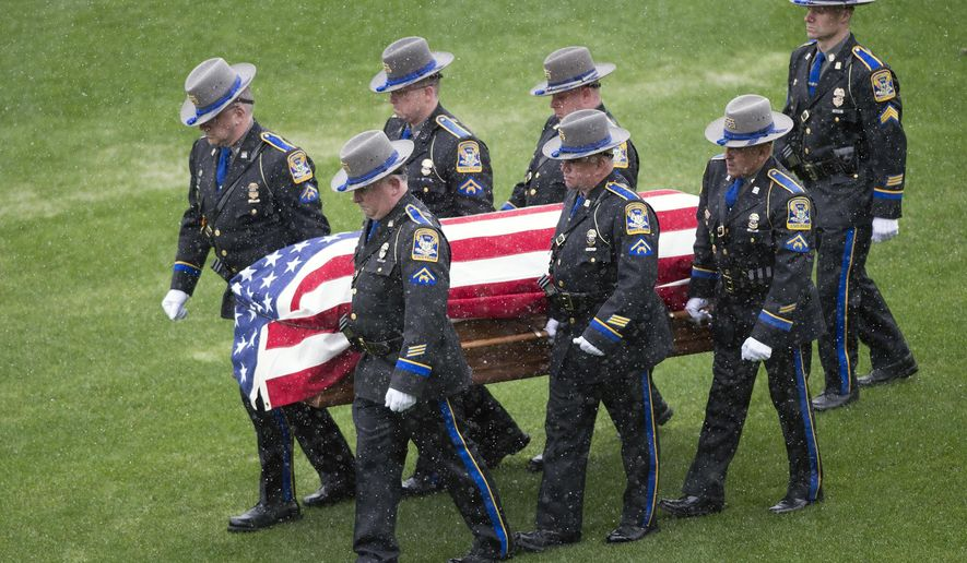 Connecticut state troopers carry the casket of Trooper 1st class Kevin Miller at Pratt and Whitney Stadium at Rentschler Field in East Hartford, Conn., Friday, April 6, 2018. The 49-year-old trooper was a 19-year veteran of the force who also served in the Marines. He died on duty March 29 when his cruiser rear-ended a slow-moving tractor-trailer on Interstate 84 in Tolland. (Patrick Raycraft/Pool Photo  via AP)