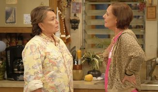 "In this image released by ABC, Roseanne Barr, left, and Laurie Metcalf appear in a scene from the reboot of the popular comedy series ""Roseanne.""  18.4 million viewers tuned in for its premiere. (Adam Rose/ABC via AP)"