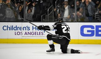 Los Angeles Kings right wing Dustin Brown celebrates his overtime goal in an NHL hockey game against the Minnesota Wild on Thursday, April 5, 2018, in Los Angeles. The Kings won 5-4. (AP Photo/Mark J. Terrill)