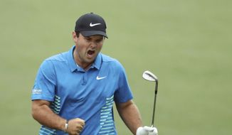 Patrick Reed celebrates his eagle chip on No. 15 during the third round of the Masters golf tournament Saturday, April 7, 2018, at Augusta National in Augusta, Ga. (Jason Getz/Atlanta Journal-Constitution via AP)