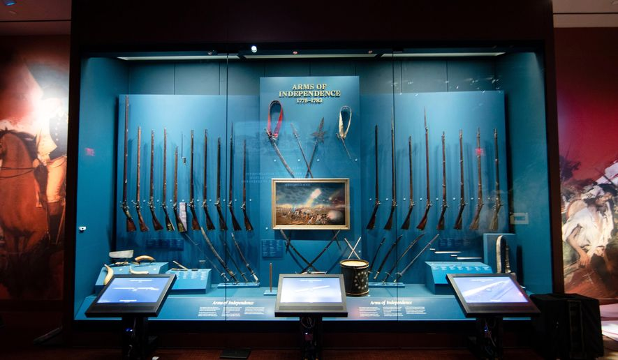This April 4, 2017, photo shows a display of weapons used during the Revolutionary War, including a fife and drum, at the Museum of the American Revolution in Philadelphia. The museum, which celebrates its first anniversary on April 19, has met expectations and it is in a healthy financial position. (AP Photo/Matt Rourke, File)