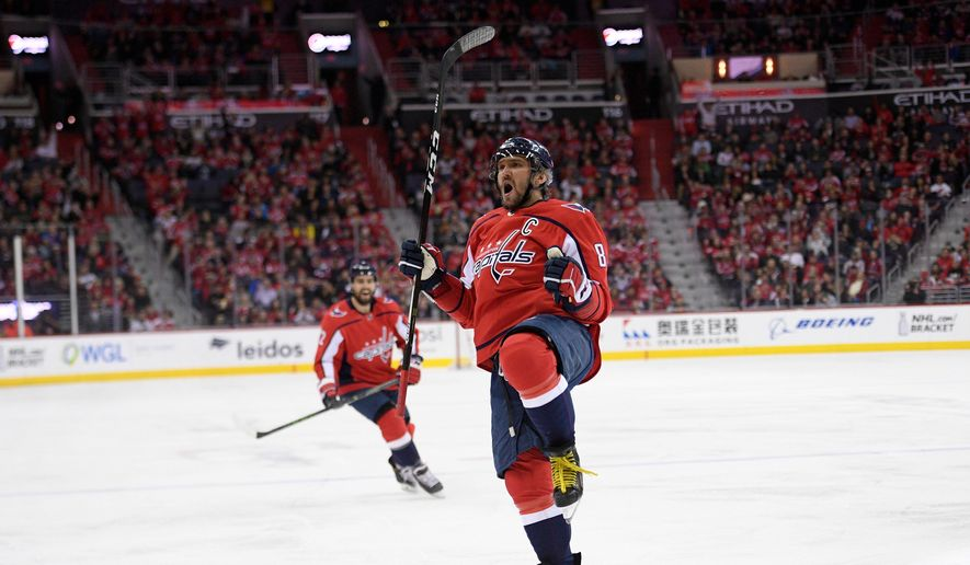Washington Capitals left wing Alex Ovechkin, of Russia, celebrates his goal during the third period of an NHL hockey game against the New Jersey Devils, Saturday, April 7, 2018, in Washington. The Capitals won 5-3. (AP Photo/Nick Wass) ** FILE **