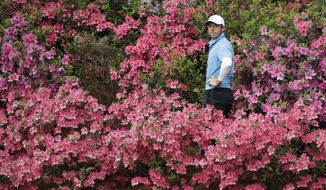 Rory McIlroy, of Northern Ireland, hits from the azaleas on the 13th hole during the third round at the Masters golf tournament Saturday, April 7, 2018, in Augusta, Ga. (AP Photo/David J. Phillip)