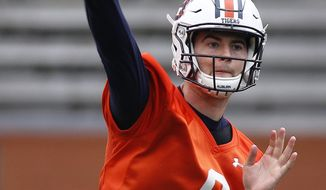 Auburn quarterback Jarrett Stidham passes the ball during the first half of a spring NCAA college football game, Saturday, April 7, 2018, in Auburn, Ala. (AP Photo/Brynn Anderson)
