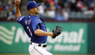 Texas Rangers starting pitcher Mike Minor (36) pitches against the Toronto Blue Jays during the first inning of a baseball game Saturday, April 7, 2018, in Arlington, Texas. (AP Photo/Michael Ainsworth)