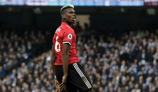Manchester United's Paul Pogba reacts after scoring his side's second goal during the English Premier League soccer match between Manchester City and Manchester United at the Etihad Stadium in Manchester, England, Saturday April 7, 2018. (AP Photo/Matt Dunham)