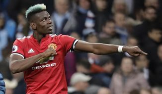 Manchester United's Paul Pogba celebrates at the end of the English Premier League soccer match between Manchester City and Manchester United at the Etihad Stadium in Manchester, England, Saturday April 7, 2018. (AP Photo/Matt Dunham)