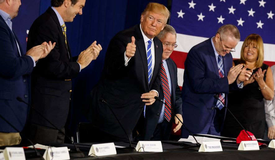"In this April 5, 2018, photo, President Donald Trump gives a thumbs up during a roundtable discussion on tax policy in White Sulphur Springs, W.Va. Trump was having it both ways over the past week, portraying a ""crisis"" at the Mexico border that demands the use of National Guard troops while boasting of a huge drop in illegal border crossings there.(AP Photo/Evan Vucci)"