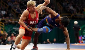 United State's Kyle Dake, left, takes India's Sachin Giri to the mat during their 79 kg match in the Freestyle Wrestling World Cup, Saturday, April 7, 2018, in Iowa City, Iowa. (AP Photo/Charlie Neibergall)