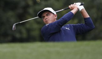 Rickie Fowler hits a shot on the forth hole during the third round at the Masters golf tournament Saturday, April 7, 2018, in Augusta, Ga. (AP Photo/David Goldman)