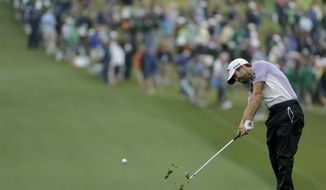 Adam Hadwin, of Canada, hits on the first hole during the third round at the Masters golf tournament Saturday, April 7, 2018, in Augusta, Ga. (AP Photo/Matt Slocum)
