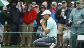 Jordan Spieth reacts to a missed putt on the 17th hole during the third round at the Masters golf tournament Saturday, April 7, 2018, in Augusta, Ga. (AP Photo/Charlie Riedel)