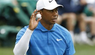 Tiger Woods reacts after his birdie on the 16th hole during the third round at the Masters golf tournament Saturday, April 7, 2018, in Augusta, Ga. (AP Photo/Charlie Riedel)