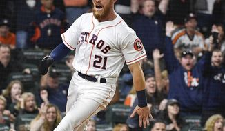 Houston Astros' Derek Fisher scores the winning run on Alex Bregman's infield single during the tenth inning of a baseball game against the San Diego Padres, Saturday, April 7, 2018, in Houston. (AP Photo/Eric Christian Smith)