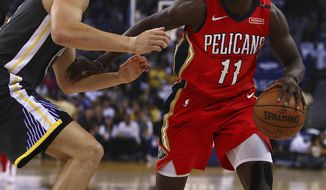 New Orleans Pelicans' Jrue Holiday, right, drives against Golden State Warriors' Klay Thompson during the first half of an NBA basketball game Saturday, April 7, 2018, in Oakland, Calif. (AP Photo/Ben Margot)