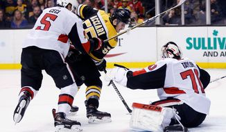 Boston Bruins' Noel Acciari (55) tries to get a shot off against Ottawa Senators' Daniel Taylor (70), of Great Britain, as Cody Ceci (5) defends during the second period of an NHL hockey game in Boston, Saturday, April 7, 2018. (AP Photo/Michael Dwyer)