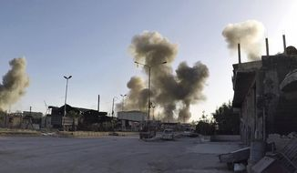 This photo released by the Syrian Civil Defense White Helmets, which has been authenticated based on its contents and other AP reporting, shows smoke rising after Syrian government airstrikes hit in the town of Douma, in eastern Ghouta region east of Damascus, Syria, Saturday, April. 7, 2018. Syrian government forces pressed their offensive against the last rebel-held town in eastern Ghouta near the capital Damascus on Saturday under the cover of airstrikes as shelling of civilian areas on both sides claimed more lives, state media and opposition activists said. (Syrian Civil Defense White Helmets via AP)