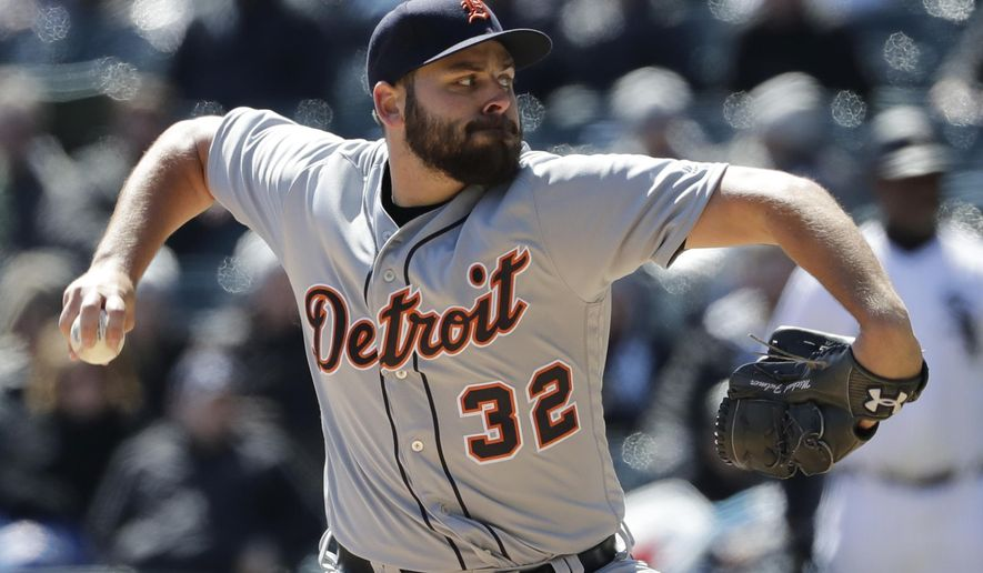 Detroit Tigers starting pitcher Michael Fulmer throws against the Chicago White Sox during the first inning of a baseball game Saturday, April 7, 2018, in Chicago. (AP Photo/Nam Y. Huh)