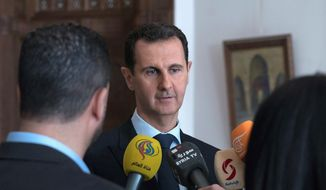 """A defiant Syrian President Bashar Assad said his country's war on terrorism will continue as long as there is """"a single terrorist"""" on territories in his country. (Associated Press)"""