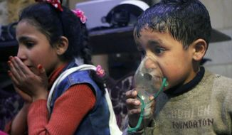 Children received oxygen through respirators after what is suspected to be a chemical weapons attack in the rebel-held town of Douma, near Damascus, Syria. Syrian rescuers and medics said the attack killed at least 40 people. (Associated Press)