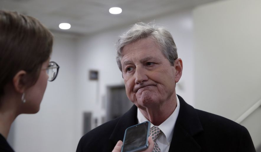 Sen. John Kennedy, R-La., speaks with a reporter on Capitol Hill, Monday, Feb. 12, 2018, in Washington. (AP Photo/Alex Brandon)