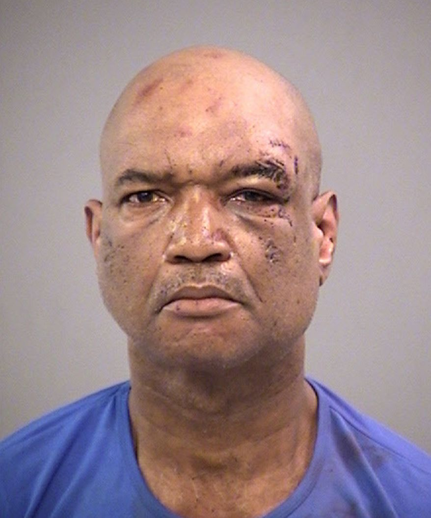 CORRECTS SOURCE TO MARION COUNTY JAIL - Gary Madison of Indianapolis is seen in an undated booking photo released Sunday, April 8, 2018, by the Marion County Jail. Madison faces three preliminary charges of battery by means of a deadly weapon. Three men suffered severe cuts when a knife-wielding Madison attacked a crowd of people in downtown Indianapolis Saturday afternoon, April 7, after being told to stop playing a siren on a bullhorn, authorities said. (Marion County Jail via AP)
