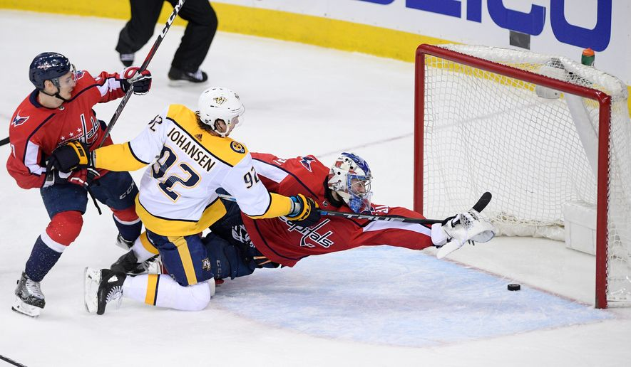 Nashville Predators center Ryan Johansen (92) scores a goal against Washington Capitals goaltender Philipp Grubauer, right, of Germany, during the third period of an NHL hockey game, Thursday, April 5, 2018, in Washington. Also seen is Washington Capitals defenseman Dmitry Orlov, left, of Russia. The Predators won 4-3. (AP Photo/Nick Wass) ** FILE **