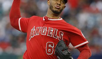 Los Angeles Angels starting pitcher JC Ramirez throws to an Oakland Athletics batter during the first inning of a baseball game in Anaheim, Calif., Saturday, April 7, 2018. (AP Photo/Alex Gallardo)