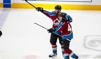 Colorado Avalanche defenseman Samuel Girard (49) is congratulated by teammate Patrik Nemeth (12) after scoring a goal against the St. Louis Blues during the first period of an NHL hockey game Saturday, April 7, 2018, in Denver. (AP Photo/Jack Dempsey)