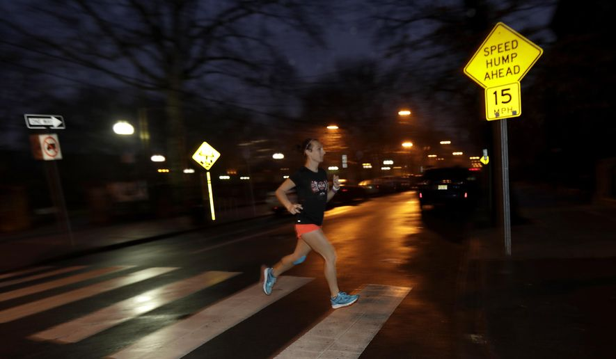 In this Wednesday, April 4, 2018, photo Amelia Gapin works out while preparing to run the Boston Marathon during an early morning jog in Jersey City, N.J. Boston Marathon organizers say transgender runners can qualify for the race using the gender they identify with. Gapin, a transgender woman from New Jersey, says running Boston this year will be a victory lap for what she has accomplished. (AP Photo/Julio Cortez)