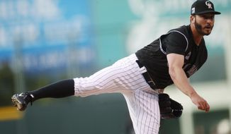 Colorado Rockies starting pitcher Chad Bettis delivers to Atlanta Braves' Ender Inciarte in the first inning of a baseball game Saturday, April 7, 2018, in Denver. (AP Photo/David Zalubowski)