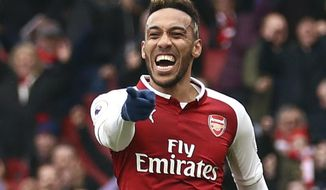 Arsenal's Pierre-Emerick Aubameyang celebrates scoring his side's first goal of the game, during the English Premier League soccer match between Arsenal and Southampton at the Emirates Stadium, in London, Sunday April 8, 2018. (Tim Goode/PA via AP)