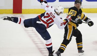 Pittsburgh Penguins' Patric Hornqvist (72) collides with Washington Capitals' Lars Eller (20) in the first period of an NHL hockey game in Pittsburgh, Sunday, April 1, 2018. (AP Photo/Gene J. Puskar) ** FILE **